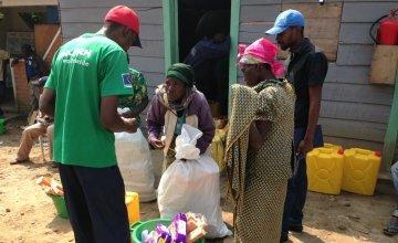 Lumoo Faida, left, receives a relief kit at Concern's base in Masisi, Democratic Republic of Congo. Photo taken by Silvia de Faveri/Concern Worldwide.
