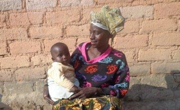 Thecla Abdul Lugenge with her youngest child Asha in Mfriga village, Mfriga ward, Njombe district, Irigna region. Photo: Mushengezi/Concern Worldwide.