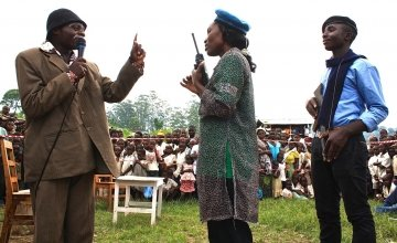 Assurance Kilonpfu, left, plays the village chief at a performance in Mahanga village, Democratic Republic of Congo. Photo taken by Charlie Walker/Concern Worldwide.