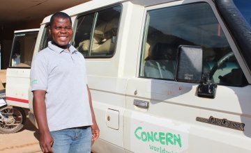 Peter Nyirenda, a driver on Concern's RELIEF project stands beside a van loaded with fertiliser at the Concern office in in Mchinji, Malawi. Peter will spend the day distributing fertiliser to farmers throughout the district. Photo by Aoife O'Grady/Concern Worldwide.