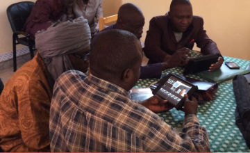 Trainers review footage in order to identify positive examples of teaching methods that they can use to educate teachers in the field. Photograph taken by: Concern Worldwide.
