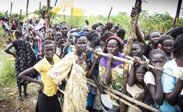 People wait in line to check into a general food distribution at a UN base on the outskirts of Juba, South Sudan. Photo taken by Crystal Wells/ Concern Worldwide