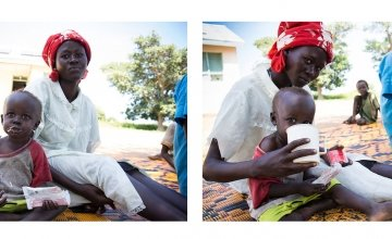 Yak sits with his mother, Achara, and eats ready-to-eat therapeutic foods at Mayom Health Care Unit in Aweil West County, Northern Bahr el Gazal, South Sudan. Photo: Crystal Wells/Concern Worldwide.