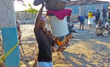A woman in La Gonave, Haiti, picks up aid after Hurricane Matthew. Credit: Leguenson Jules-Saint.