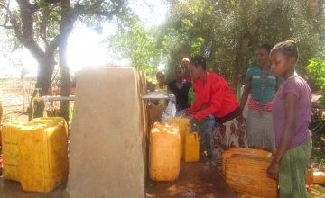 Filema collecting water from the point 150 metres from her home. Photo: Megan Stirling, Concern Worldwide.]