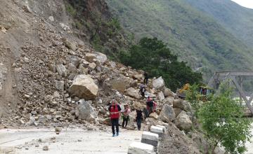 Bulldozers work to re-open a bridge at Khurkot, Ramechhap. Photo taken by Helvetas.