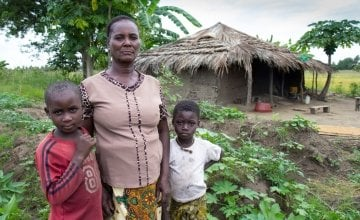 Albertina (pictured here with her grandchildren) is taking part in a farmer field school run by Concern. Photo taken by Crystal Wells.
