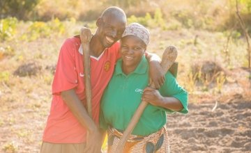 Chibala, 55, and Catherine, 43, work together in their field. Through attending gender training as part of Concern's RAIN programme he has now 'learned to help' his wife. Photo: Gareth Bentley.