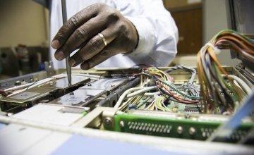 Engineers at Kenyatta Hospital in Nairobi work to repair broken medical equipment. Photo: Concern Worldwide.