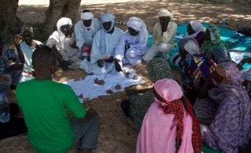 A community group discuss the results of the vote on impact and frequency of hazards in order to prioritise the most important ones in Tcharow, Chad