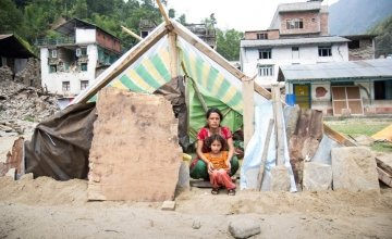 Chameli Darji sits with her youngest daughter, Apita, in their makeshift shelter in Talamarang in Sindhupalchok District, Nepal, one of the hardest hit areas by the 7.8-magnitude earthquake that hit the country on April 25th. Photo taken by Crystal Wells / Concern Worldwide.