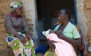 Kisa Ngiumba (33), Care Volunteer, with Aida Jugo (43), breastfeeding mother in Tanzania. Photo: Martha Maguire.