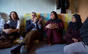 Concern Worldwide CEO, Dominic Mac Sorley and Lebanon Country Director, Elke Leidel with residents of a collective centre for Syrian refugees in Northern Lebanon. Photo: Kieran McConville/Concern Worldwide.