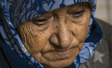 """Iman"" lost 19 members of her family, including her husband, all of her children except one daughter, and all of her grandchildren except one grandson in a bombing attack on their home in Syria. Photo: Kieran McConville / Concern Worldwide."