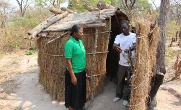 Jean Claude Mwilambwe shows to a Concern officer his latrine with the hand-wash installation. Photo: Silvia De Faveri.
