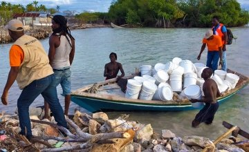 NFI's are unloading off shore at Grand Vide for a joint distribution between Concern and World Vision. Photo: Peter Doyle/Concern Worldwide.