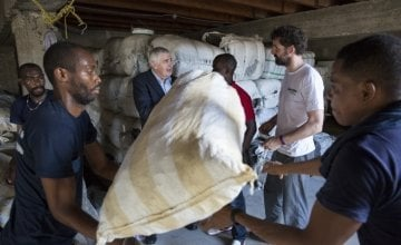 Dominic MacSorley in conversation as rope and hygiene kits are loaded for distribution to those affected by Hurricane Matthew on the island of La Gonave. Photo: Kieran McConville/Concern Worldwide.
