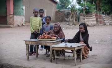 Children set up a stall to sell their wares to early morning passers-by in the town of Kouango, Central African Republic. Photo: Kieran McConville