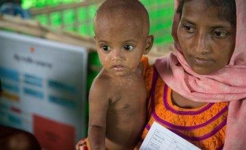 Lelia* and Tamir* at Concern Worldwide's Nutrition Support Centre at Hakim Para camp in Cox's Bazar, Bangladesh. Photo: Kieran McConville/Concern Worldwide.