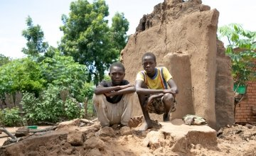 Brothers, Charity Raphael (16) and Fraction Raphael (14) standing on what's left of their home. Their home was washed away with all their belongings. Photo: Gavin Douglas/Concern Worldwide