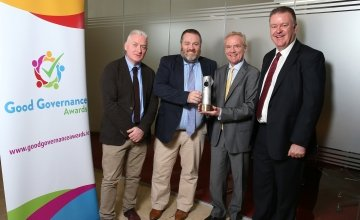 Jim Hynes, Richard Dixon and Tom Shipsey from Concern accepting a special recognition award from Diarmuid O'Corrbui, CEO of the Carmichael Centre. Photo: Marc O'Sullivan/Concern Worldwide.