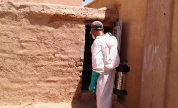 A member of Concern's pest control team in Syria, spraying a building in order to control the spread of pests and insects. Photo: Concern Worldwide.