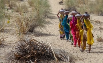 Community women carrying water in mud pots from the communal well  Umerkot district Sindh province Pakistan  April 2017  (00000003).jpg