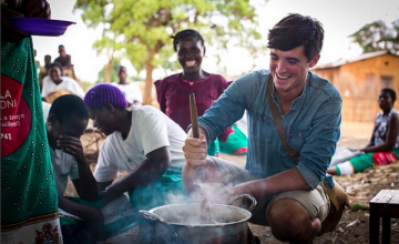Food writer, photographer and TV presenter Donal Skehan with 'lead mothers' who are trained by Concern Wolrdwide on nutrition and teach women in the Kachere Care Group about how to make a nutritious meal for their families with five major food groups. Location: Kaigwanga Village, Mchinji, Malawi. Photo: Jennifer Nolan / Concern Worldwide.