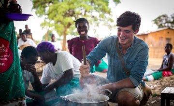 Food writer, photographer and TV presenter Donal Skehan with 'lead mothers'in Kaigwanga Village, Mchinji, Malawi. Photo: Jennifer Nolan / Concern Worldwide.