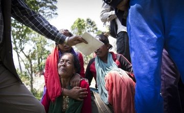 A woman sobs after a major earthquake rocked Nepal on Tuesday 12 May near Bhirkot in Dolakha district. Photo taken by Crystal Wells / Concern Worldwide.
