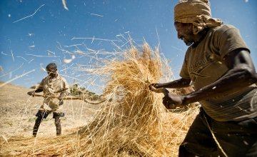 Two men farming on the cover of the Global Hunger Index Cover. Photo: Global hunger Index.