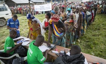 Concern Worldwide staff distributing aid to displaced families in DRC where 13 million people are in urgent need of aid