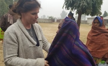 Concern Country Director Eileen Morrow helping to distribute blankets to vulnerable beneficiaries. Photo: Concern Worldwide.