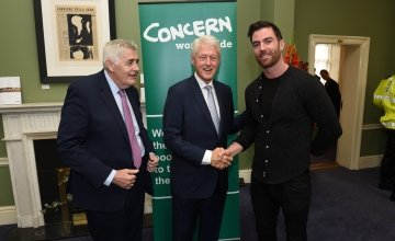 Concern Ambassador Michael Darragh Macauley continued his All-Ireland-winning celebrations by having an unexpected encounter with President Bill Clinton at Concern's 50th Anniversary Conference at Dublin Castle on September 7, 2018.