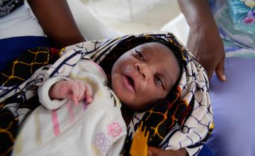 A newborn baby boy at the Community Care Center in John Logan Town, Grand Bassa, Liberia built by Concern Worldwide. Photo taken by Kieran McConville, 2015.