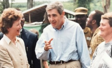 Dominic MacSorley and Jerry Merx talking with Mary Robinson during her visit to Concern's programmes. As President of Ireland, she was one of the first head's of state to visit Rwanda in the wake of the genocide. Photo: Concern Worldwide.