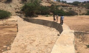 Concave-shaped reinforced concrete sand dam with riprap built in 2018. Dinqaal community, Woqooyi Galbeed. Photo: Lopez-Rey, 2019.