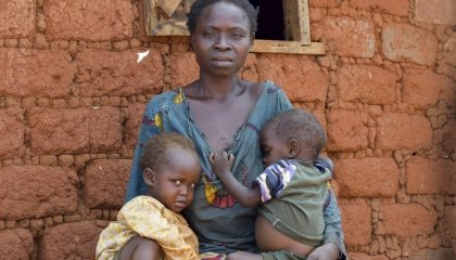 Marie Mbendu (40) with 15-month-old twins Dorcas and Moise outside their home. Photo: Darren Vaughan / Concern Worldwide.