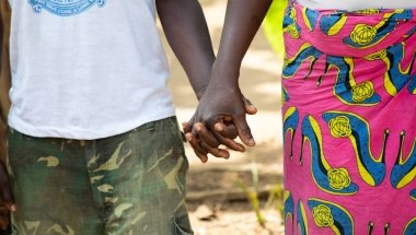 Hands holding. Photo: Gavin Douglas / Concern Worldwide.