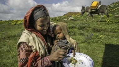 Mavema Mohammed, 25, and her 23-month-old son receive supplemental food at a health post in the Amhara Region of Ethiopia, 2013. Photo: Jiro Ose / Concern Worldwide.