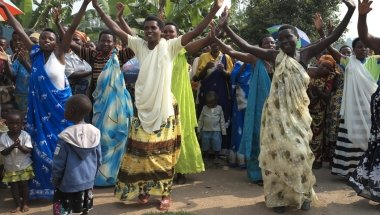 Women dance at a community health center in the southern Rwandan village of Gisagara. Photo: Cheney Orr / Concern Worldwide.