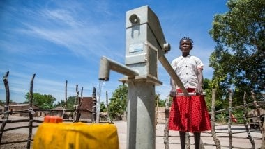 15 year old Liliana Mwenza wa llunga says the new water point and other interventions by the Concern-led WASH consortium in her village, Mulombwa, has had a very positive impact on family life. Photo: Kieran McConville/ Concern Worldwide.
