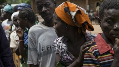 A woman queues for humanitarian assistance in Nsanje, Malawi. Photo: Alexia Webster/PANOS