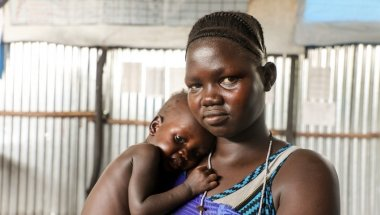 South Sudanese refugee Nyakoun Tut with her son Thujin after he was treated for malnourishment by Concern Worldwide at a refugee camp in Gambella, Ethiopia