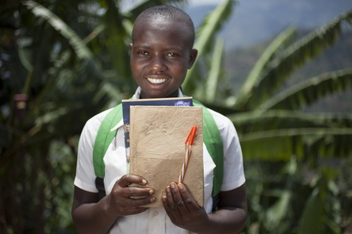 Amida Tuyishimire (14) with her school books and pens. Photo: Abbie Trayler-Smith / Concern Worldwide.
