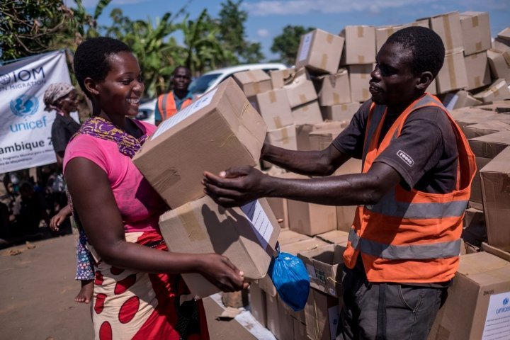 "Elina Joao (22) collects supplies from a Concern distribution in Ndeja, Mozambique. They include hygiene kits, kitchen kits, shelter and bedding materials. ""These are all the things that we lost in the flood"". Photo: Tommy Trenchard / Concern Worldwide"
