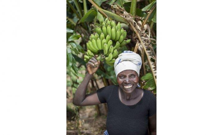 Meresiyana Cimpaye, 40, with her banana plants at her home in Bukinanyana, Cibitoke, Burundi. Photo: Abbie Trayler-Smith / Concern Worldwide
