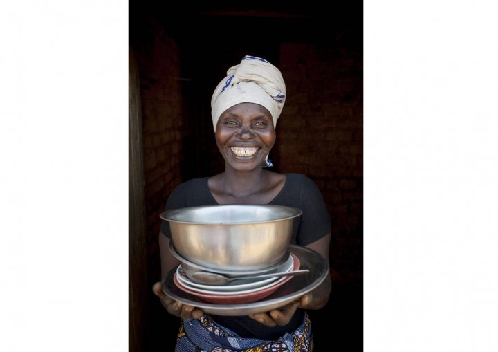Meresiyana Cimpaya, 40, shows off her new plates, bowls, and pans in Burundi. Photo: Abbie Trayler-Smith / Concern Worldwide