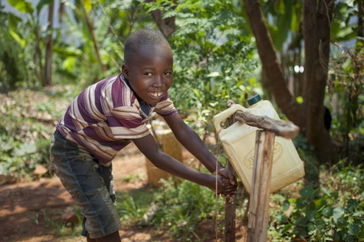 Six-year-old Kevin is now able to wash his hands and keep himself safe from illness. Photo: Abbie Trayler-Smith / Concern Worldwide