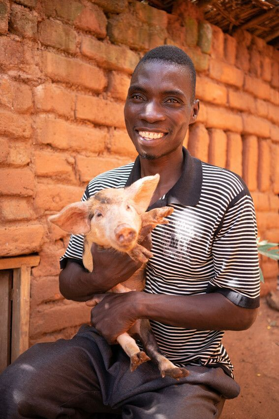 Aubrey with one of his sow's piglets, in Burundi. Photo: Chris Gagnon / Concern Worldwide